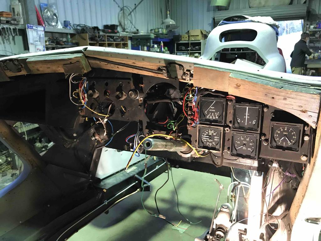 Dash with restored gauges installed, timber is being renewed, new wiring harness installed